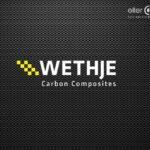Logo auf Carbonhintergrund der Wethje Carbon Composite GmbH
